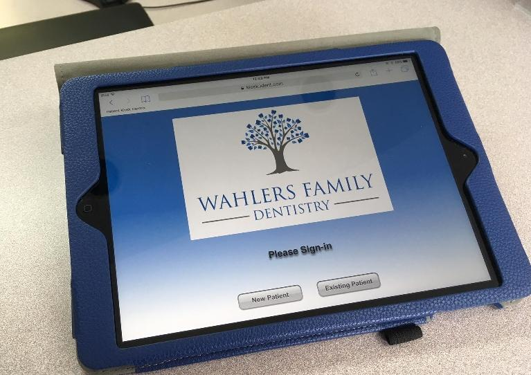 One of the iPads that can be used by patients to update or view their information.